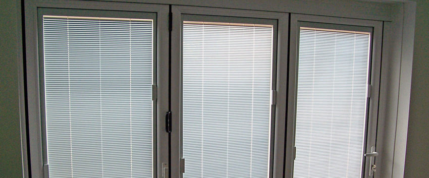 Slim upvc bi fold doors folding doors 2 u for Blinds for upvc patio doors