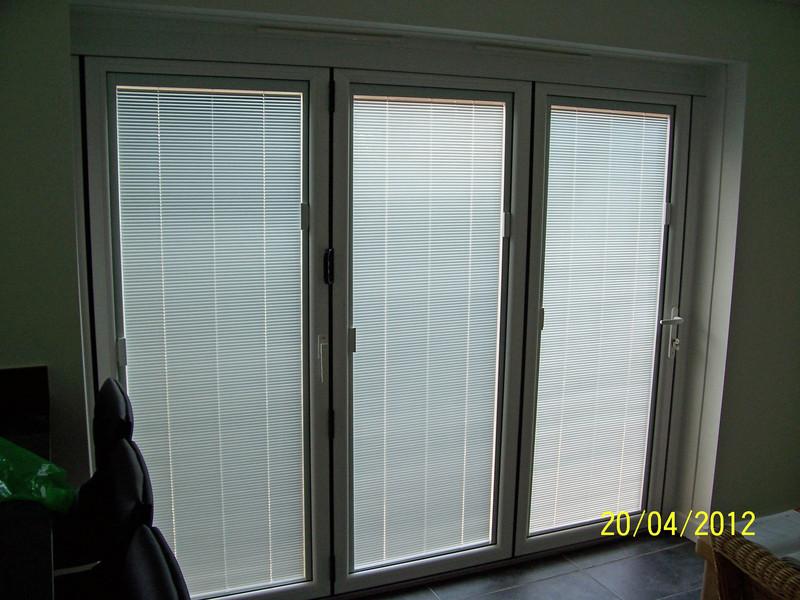 Upvc bi fold door gallery folding doors 2 u for Blinds for upvc patio doors