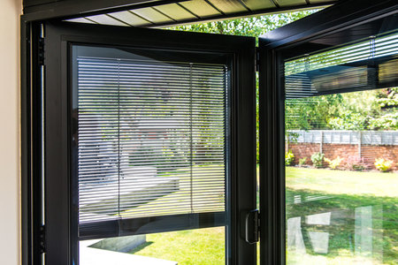 black bifold door with integral blinds