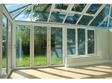 Convervatory featuring white-framed bi-folds - inside.