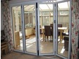 4 Panel upvc bifold door between main house and conservatory.
