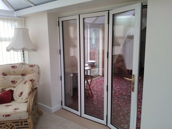 Slim upvc bi fold doors folding doors 2 u for Upvc folding doors
