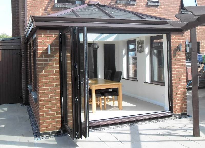 Brown 3 Panel Aluminium Bifold Door Fitted To A Livin Room Style Conservatory Also Supplied By