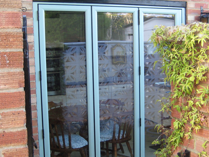 2390 x 2090 wood grain upvc bi folds folding doors 2 u for Upvc french doors 1790 x 2090mm
