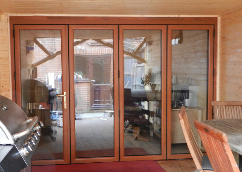 2990 x 2090 Wood Grain uPVC Bi-folds | Folding Doors 2 U
