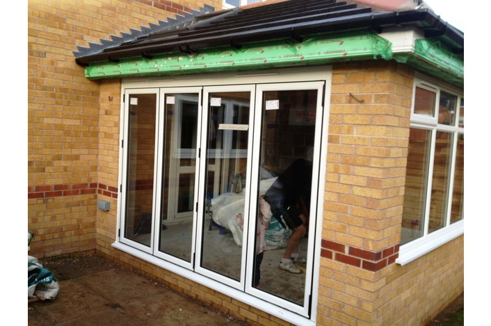 White Timberlook upvc bifold door - open