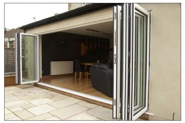 White framed aluminium bi-folding doors.