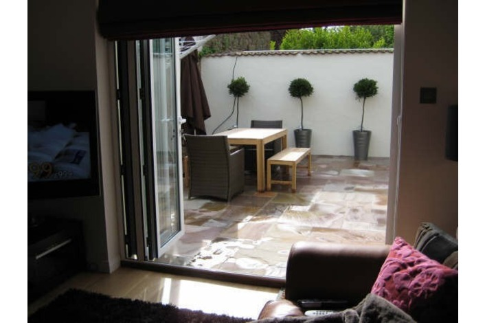Bi-folds leading onto the patio seating area.