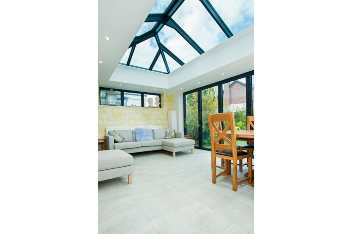 Wonderful living area with our great black framed bi-folds.