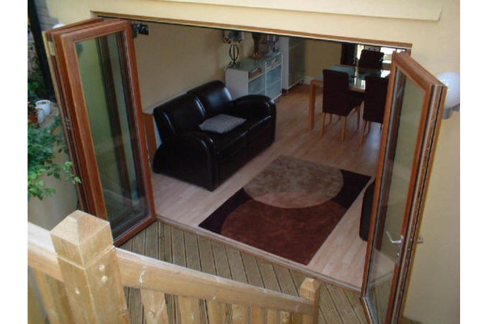 open wooden bi-fold doors