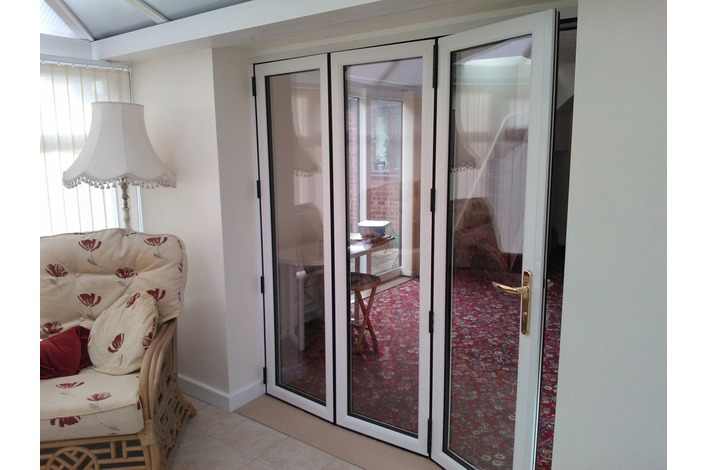 3 Panel upvc bifold door with traffic door