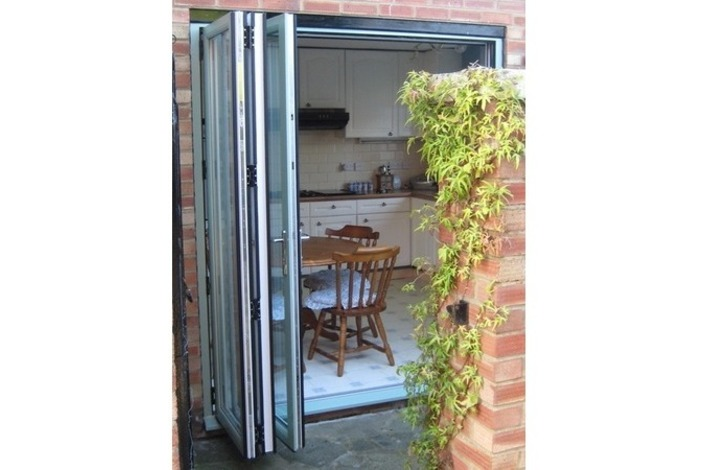 Chartwell light green on white bifold door - open