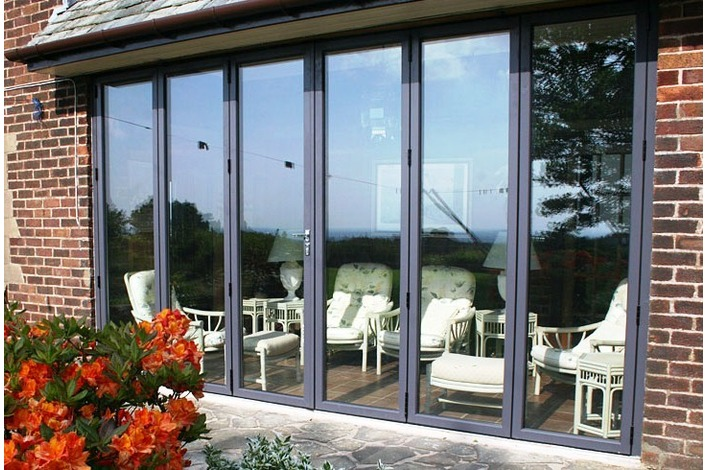 6 panel black varnished timber bi-fold doors