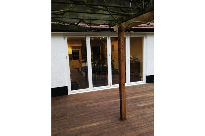 4 Panel hardwood folding door in white paint finish