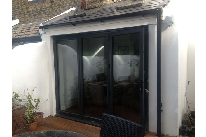 Anthracite grey aluminium bifold door featured on Channel 4 TV