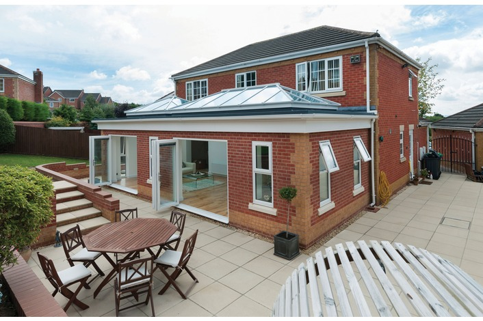 Clean & tidy patio space with our stylish white framed bi-folds.