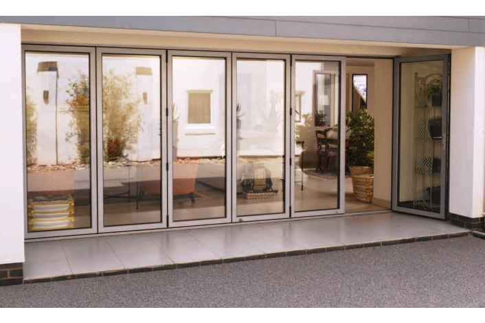 Grey aluminium 5 panel folding door with traffic door open