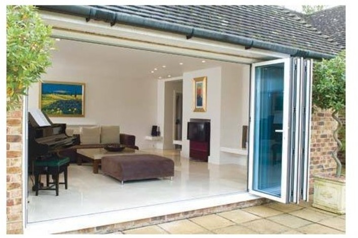White-framed bi-folding doors with blue tinted glass.