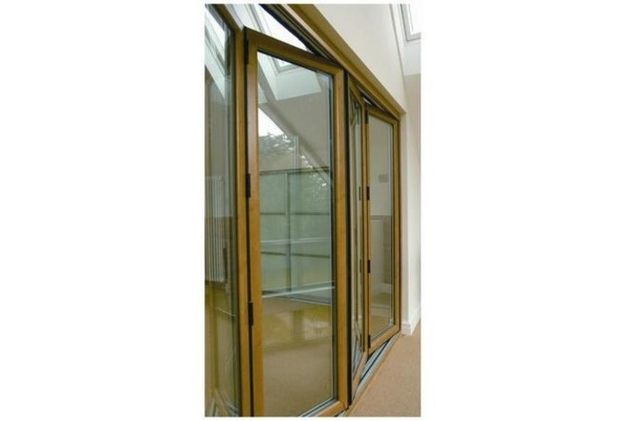 Wooden-frame bi-folding doors.