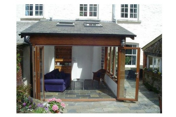 open timber bi-fold doors