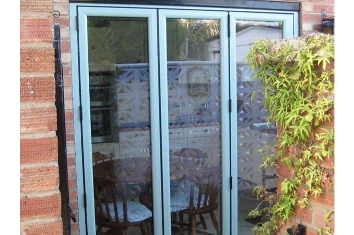 Chartwell light green on white bifold door - closed