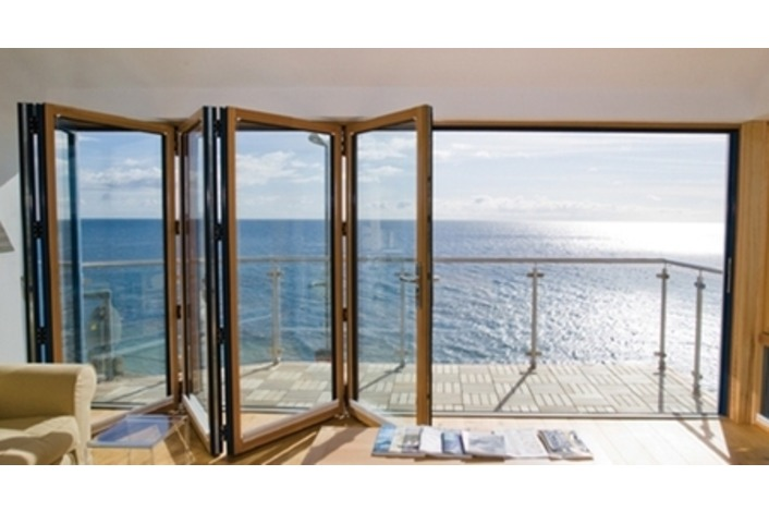 timber bi-fold doors leading out to a balcony