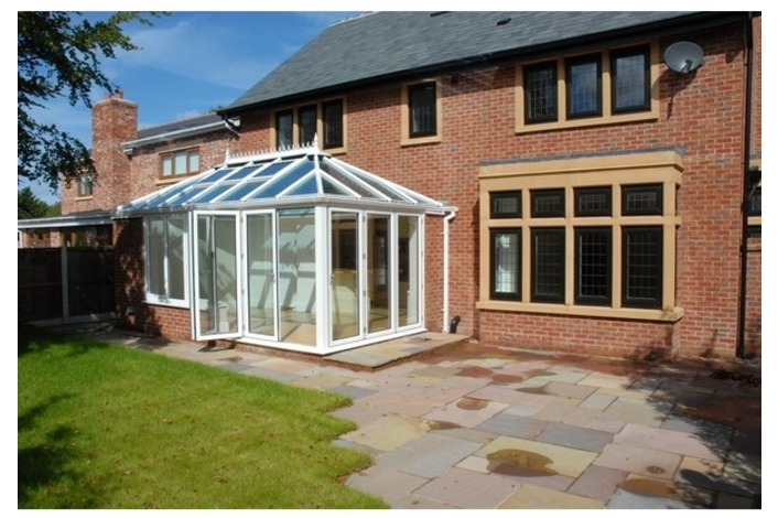Convervatory featuring white-framed bi-folds.