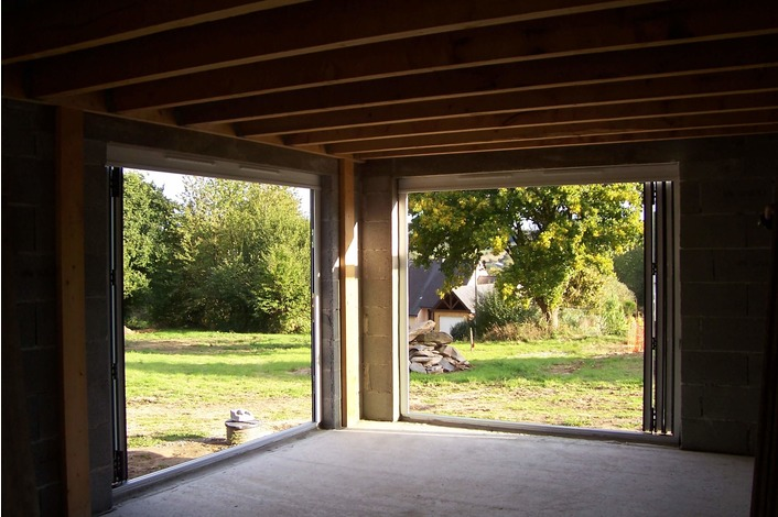 Internal image of white upvc folding doors supplied to a customer in France.