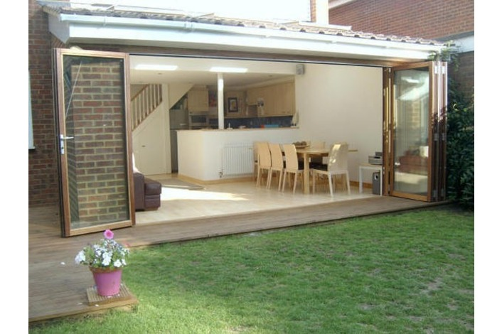 open bi-fold doors leading to lawn