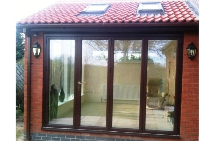 Rosewood on white upvc bifold door